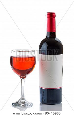 Red Wine In Glass Next To Full Bottle On White Background