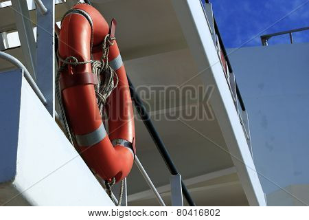 lifebuoy on the guard railing of the ship