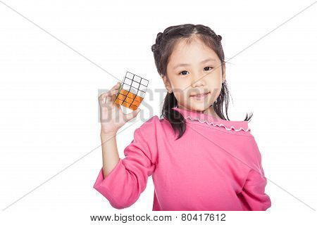 Asian clever little girl hold cube