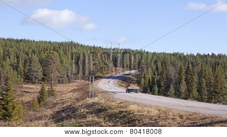 Main road through Nordic rural countryside.