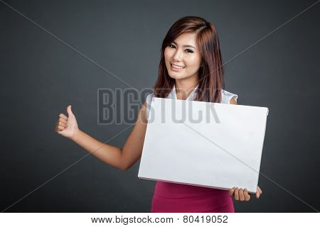 Asian Girl Hold A Blank Sign And Hitchhiking