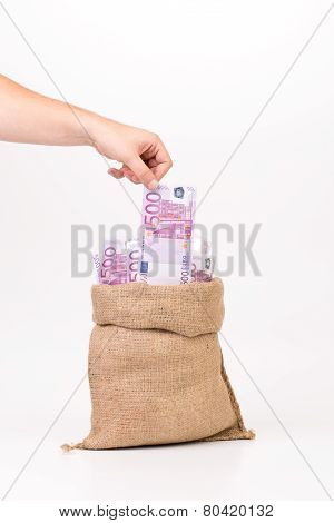 Man hand taking money euro bill from bag.