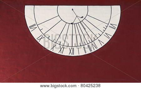 Semicircular wall sundial