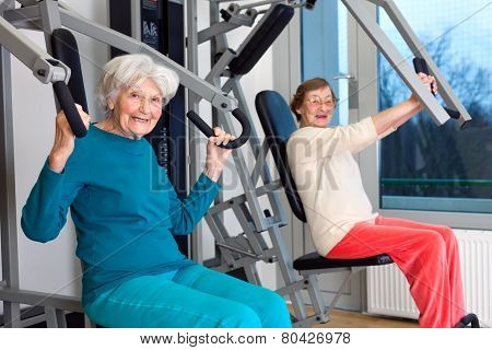 Happy Elderly Women Working Out At The Gym