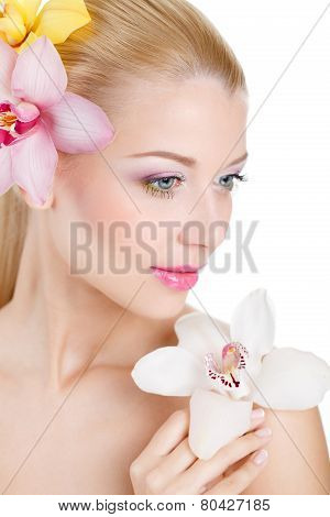 Portrait of a beautiful woman with flower in hair.