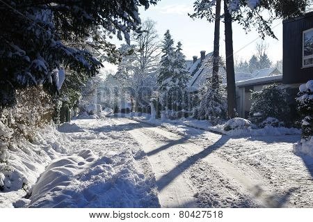 Stree Full Of Snow With Sun And Blue Sky