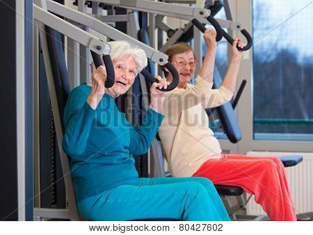 Healthy Old Women Exercising At The Gym