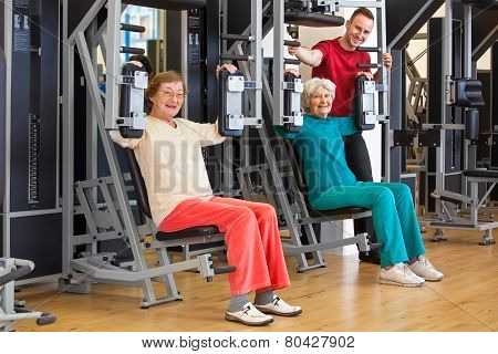 Smiling Elderly Women At The Gym With Instructor