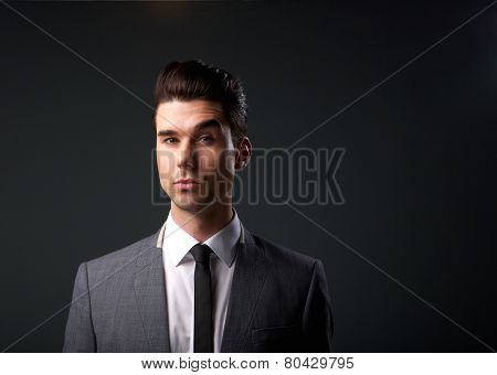Fashionable young man in suit and tie