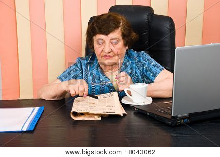 Elderly Adult Woman Reading News