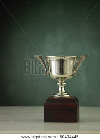 close up of the trophy in front of chalkboard