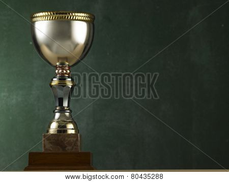 big trophy in front of the black board