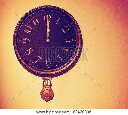 a vintage wall clock toned with a retro vintage instagram filter effect