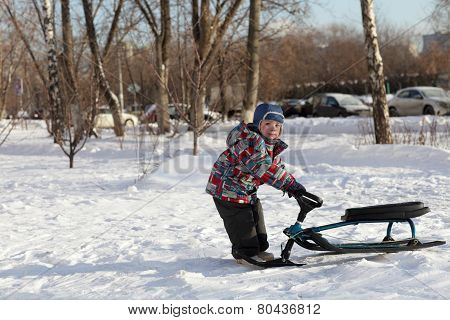 Boy With A Snow Racer