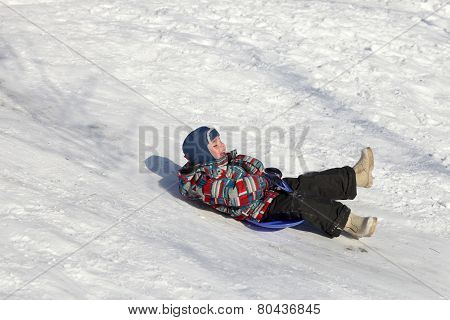 Child Slides On A Board