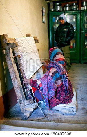 Tibetan Woman Weaving