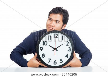 Asian Man Bored With A Clock