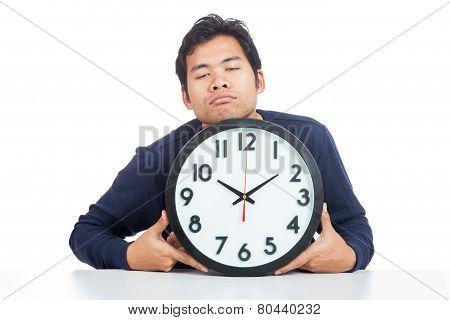 Asian Man Is Sleepy With A Clock