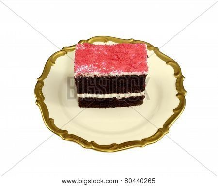 Piece of a delicious chocolate cake with ising on a decorative plate