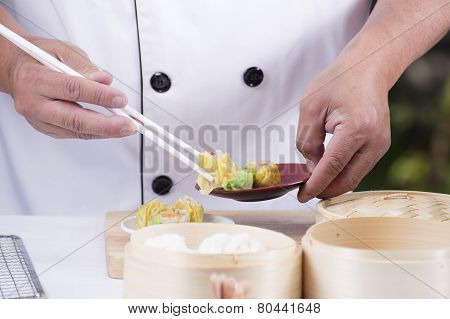 Chef Using Chopsticks Hold Chinese Dumpling