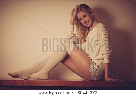 Beautyful Teenage Woman Resting on chest of drawers