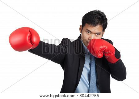Asian Businessman Punch With Red  Boxing Glove