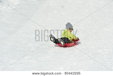 Boy On Sledge