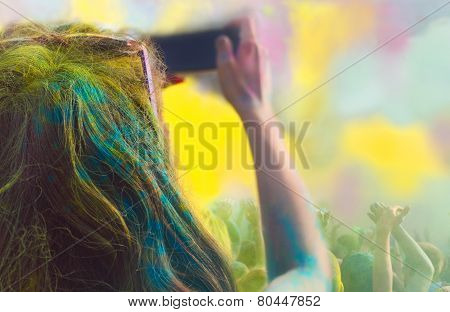 Woman Taking Photo On Mobile Phone On Holi Color Festival