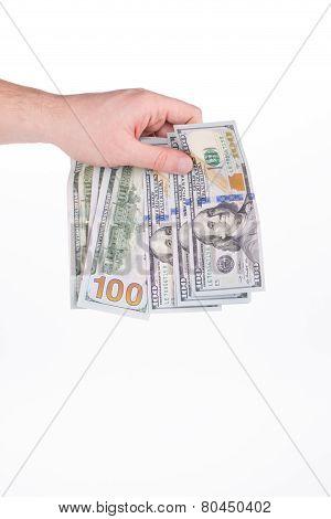 Hand holding hundred dollar bills.