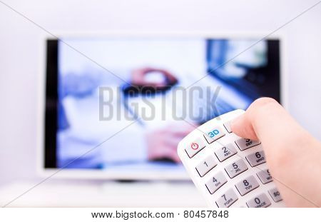 Man Presses The 3D Button On The Remote Control.