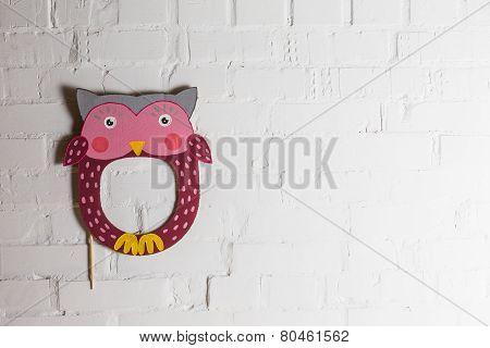 Bright Cardboard Masks On A White Brick Wall.