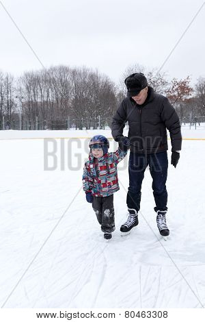 Grandfather With Grandchild At The Skating Rink