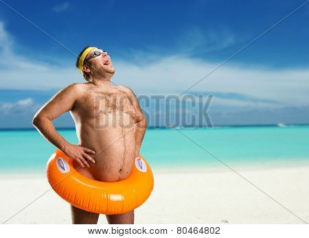 Strange naked man on the beach