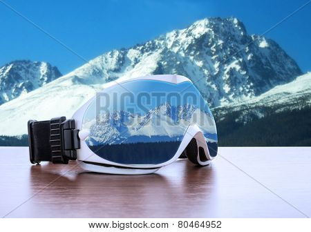 Ski glasses against mountains