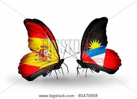 Two Butterflies With Flags On Wings As Symbol Of Relations Spain And Antigua And Barbuda