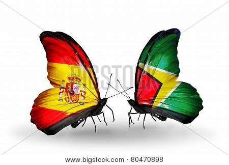Two Butterflies With Flags On Wings As Symbol Of Relations Spain And Guyana