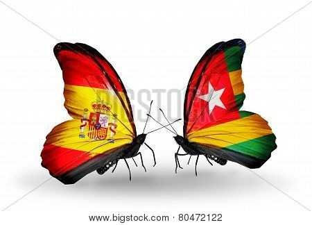 Two Butterflies With Flags On Wings As Symbol Of Relations Spain And Togo