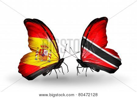 Two Butterflies With Flags On Wings As Symbol Of Relations Spain And Trinidad And Tobago