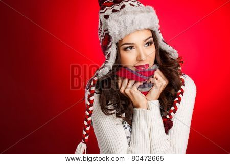 Studio portrait of woman in winter hat.