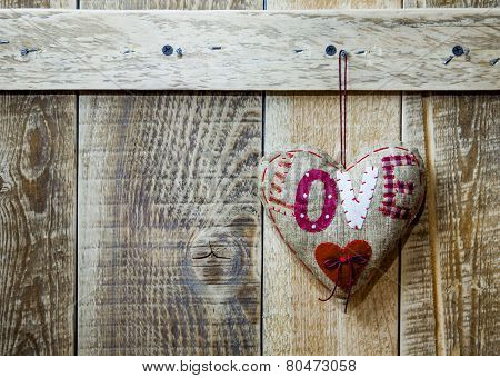 Handmade Heart Hanging Over Rustic Wooden Background. Symbol Of Love.