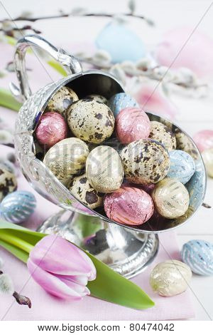 Colorful chocolate easter eggs in metal vase