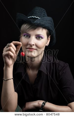 Young Woman In Hat Holding Cherry
