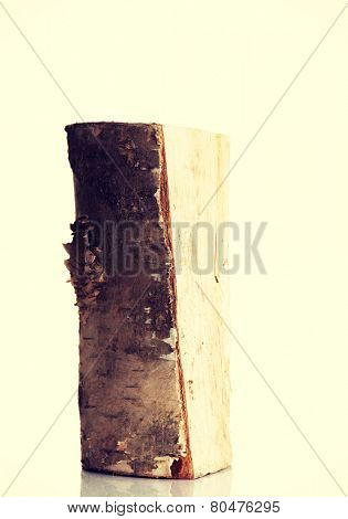 One separated piece of light wood.