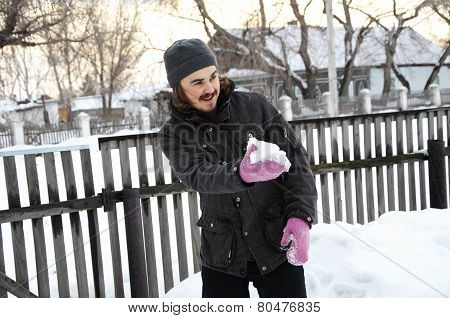Man Playing With Snowball