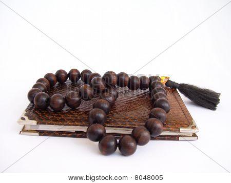 note pad and rosary beads