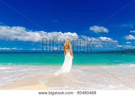 Beautiful Blond Fiancee In White Wedding Dress With Big Long White Train Stand On Shore Sea