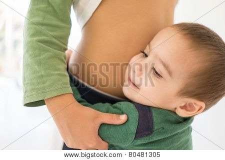 Portrait of child hugging his bigger brother