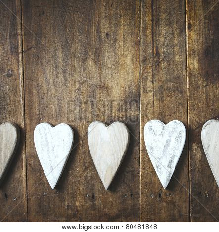 Heart shaped decoration over weathered wood