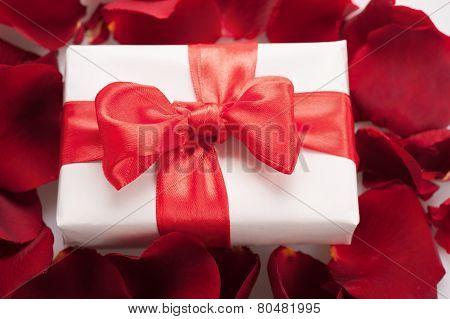 Present box in rose petals