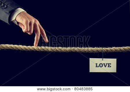 Man Walking His Fingers Along A Length Of Rope Towards Love